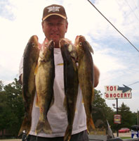 Man with nice stringer of Walleye from Norfork Lake