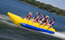 girls on yellow tube on lake