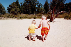 Toddlers walking in sand at Norfork Lake