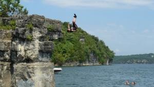 Boy jumps off bluff at Norfork lake