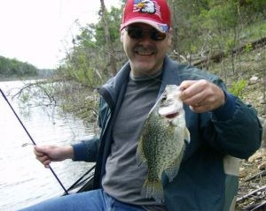 Fisherman holding Crappie fish