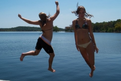 Girls jump into Nofork Lake