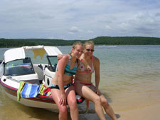 Two girls sitting on boat norfork Lake