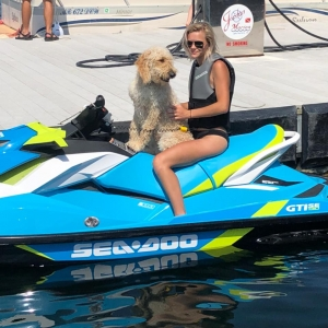 Girl and dog on jet ski