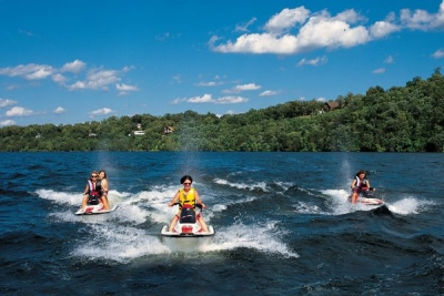 Jet skis race across Norfork Lake.