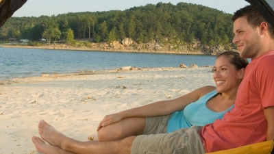 Couple camping on Sand Island at Norfork Lake