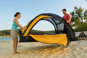 Couple camping on sandy Norfork Lake beach
