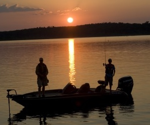 Fishing Norfork Lake at Sunset by boat