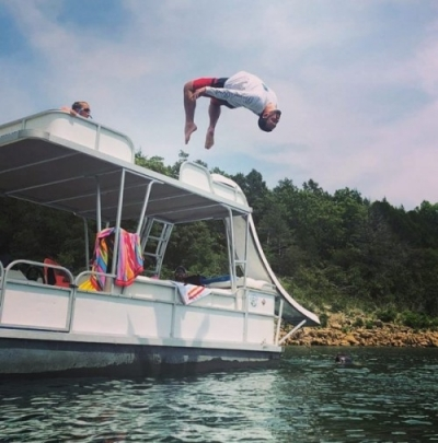 Teen flips off pontoon boat.