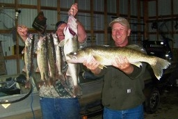Fishermen with catch of walleye on Norfork Lake