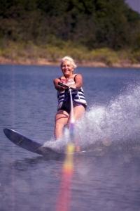 Woman wake boarding on Norfork lake
