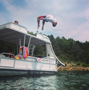 Man back flips off boat into water