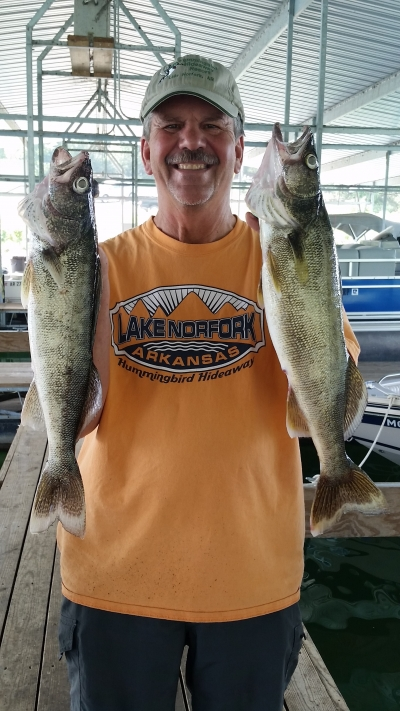Man with two walleye fish