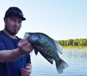 Fisherman with crappie Norfork Lake