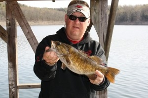 Fisherman with Bass fish on Norfork Lake