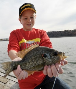 Boy with crappie fish on Norfork Lake