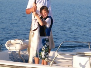 Boy with striped bass on Norfork Lake