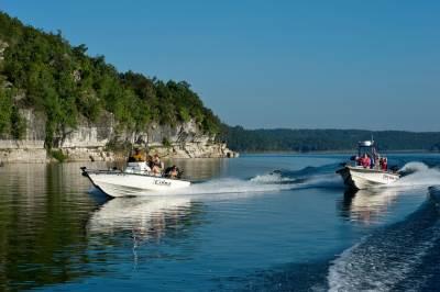 Boats zipping across Norfork Lake