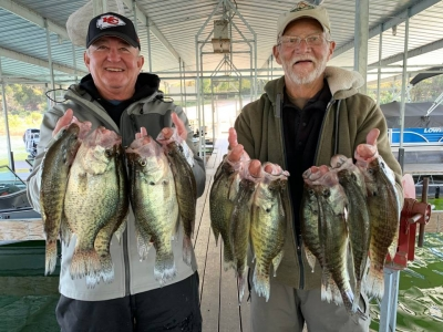 Two fishermen with lots of crappie fish