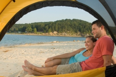 Couple Camping on Sandy beach on Norfork Lake